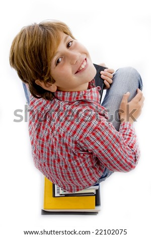top view of boy with pile of books against white background - stock photo