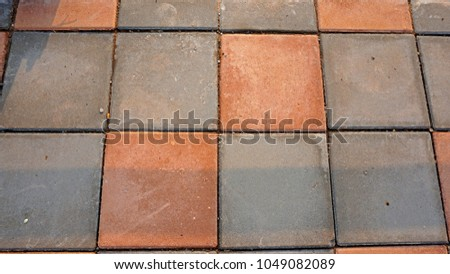 Top View Of Brick Cobblestone Walking On Pavement Outside The Building Is A Rectangular Shape