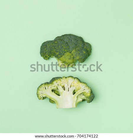 Top view of broccoli on a pastel green background. Seasonal vegetable. Minimal concept. Vegan food.  The concept of a healthy diet