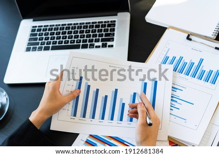top view of Business consultant meeting to analyze and discuss company performance On financial report paper Investment advisor, financial advisor, and accounting concept