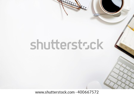 Top view of Business desk, work place with cup of coffee,Empty workspace on white table.