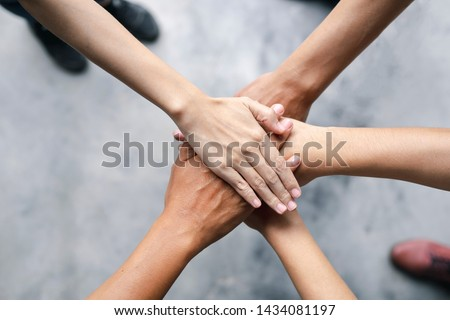 Top view of business people put hands together. Team work and unity business concept
