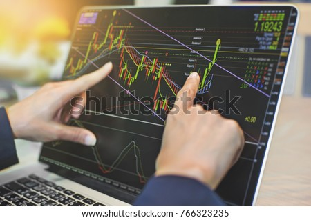 top view of business people working with stock trading forex with technical indicator tool on laptop