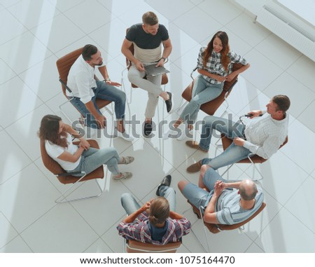 top view of business team discussing new ideas. #1075164470