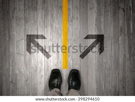 Top view of businessman legs choosing his way