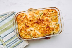 Top view of cauliflower, broccoli and cheese casserole in rectangular shape glass baking dish.