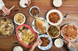 Top view of Chinese family enjoying dinner