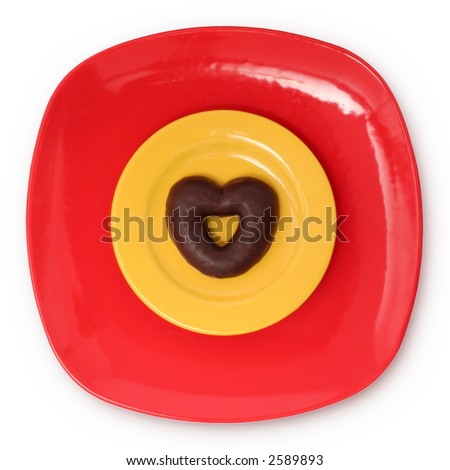 Top view of chocolate heart on plates