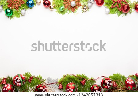 Top view of Christmas background, template with decorations of big red balls, gift boxes on fir tree on with white background with copy space, ornaments for new year greetings. #1242057313