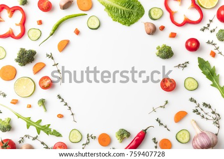 Top view of circle of cut vegetables isolated on white