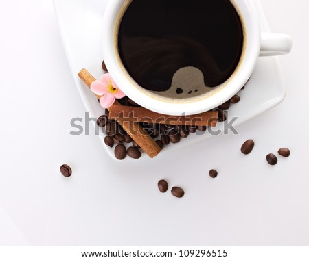 top view of coffee cup with decoration on white background
