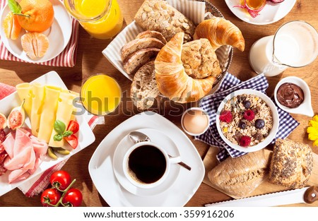 Top view of coffee, juice, fruit, bread and meat on table #359916206