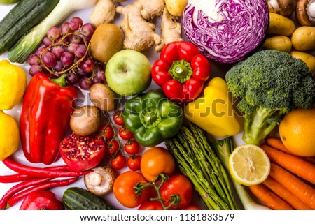Top view of colorful fresh vegetables and fruits, ideal for a balanced diet, contains broccoli, cucumber, onion, asparagus, peppers, carrots, potatoes, apple, orange, tomatoes, lima, grape #1181833579