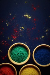 top view of colorful traditional holi powder in bowls isolated on white background.Space for text . happy holi.Concept Indian color festival called Holi