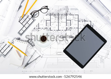 Top View of Construction plans with Tablet and drawing Tools on blueprints; Architectural and Engineering Housing Concept.