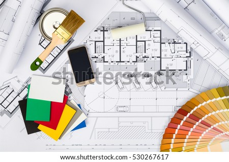 Top View of Construction plans with whitewashing Tools,Colors Palette and Smart phone on blueprints; Architectural and Engineering Housing Concept.