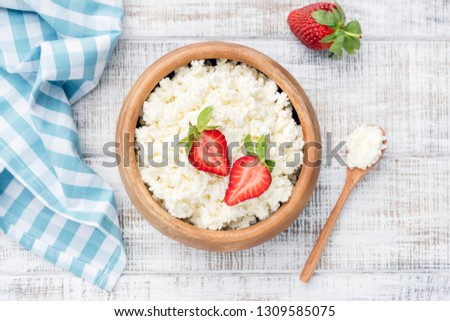 Top View of Cottage Cheese, Tvorog, Curd Cheese on old rustic white wooden background