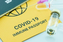 Top view of COVID-19 immune passport, a document attesting that its bearer is immune to a contagious disease e.g COVID-19. A record proving a traveler, people or someone has received certain vaccines
