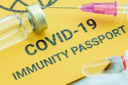 Top view of COVID-19 immunity passport, a document attesting that its bearer is immune to a contagious disease e.g COVID-19. A record proving a traveler, people or someone has received certain vaccine