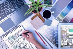 Top view of creative's (architect & interior designer) working at desk with laptop, tablet, drawing sketch / Home renovation & decoration concept