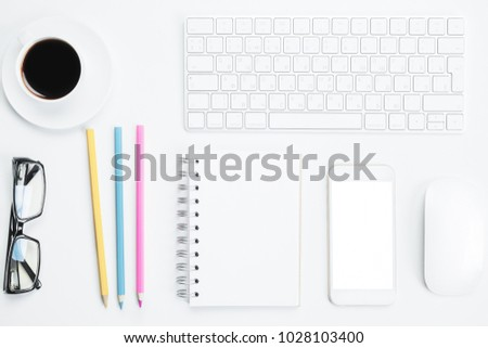 Top view of creative white office table with blank smartphone, glasses, supplies and other items. Mock up