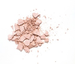 Top view of crushed pink compact highlighting powder. Closeup shot