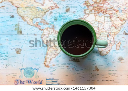 Top view of cup coffee one the word map for Traveler accessories and items man with backpack and visiting for planning travel vacations.  Travel and Summer holiday concept  #1461157004