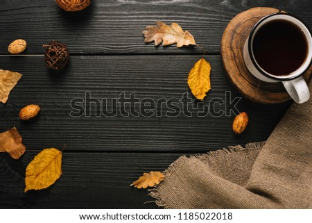 Top view of Cup of black coffee with autumn leaves