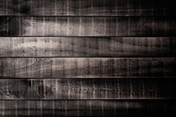 Top view of dark brown and black wood texture background, wooden table.