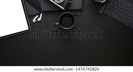 Top view of dark stylish workplace with office supplies and blank screen tablet   #1476742826