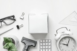 Top view of desktop with Blank of Notepad, Pen, Clock and Antidepressants on white Background. Flat lay. Copy space. Stop Depression. Education, Exam, Work Stress or Tension concept. Minimal style.