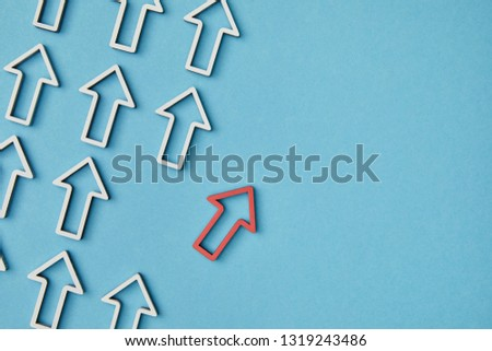 top view of diagonal rows with white arrows with red pointer on blue background #1319243486