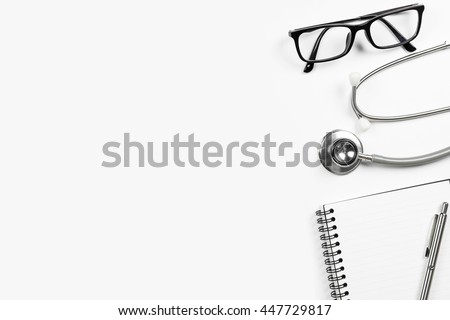 Top view of doctor desk table with stethoscope and notebook with pen. Top view with copy space, flat lay.