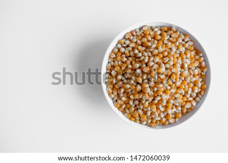 top view of dried corn beans, corn seeds on isolated white backround.
