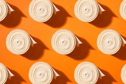 Top view of elastic bandage pattern, isolated against colorful background.