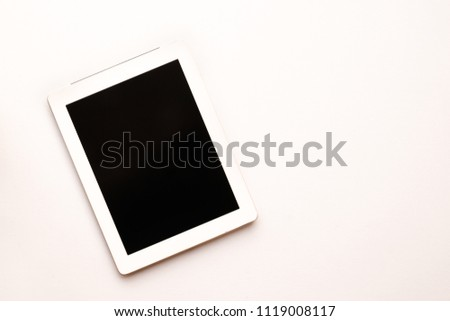 Top view of Empty blank black screen on White modern tablet computer isolated on white background. Technology picture view. Flat lay creative design to business office education on photo view.