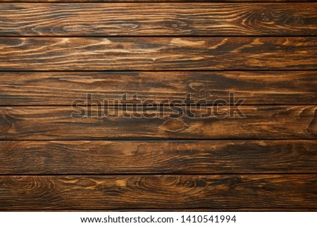 top view of empty brown wooden surface with copy space #1410541994