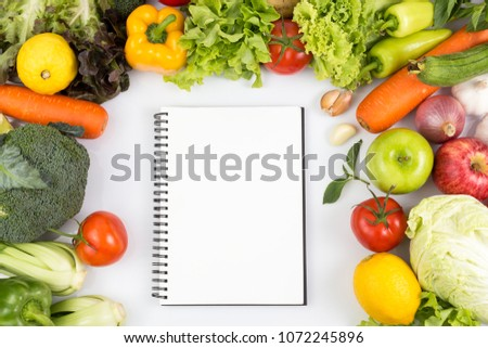 Top view of Empty notebook with fruits and vegetables Isolated on a white background with copy space #1072245896