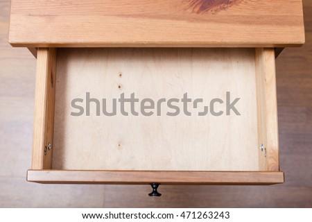 top view of empty open drawer of nightstand