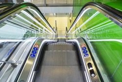 Top view of escalators, green color combination. panoramic angle of escalator detail.