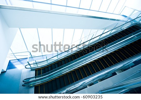 Top view of escalators in modern office building.