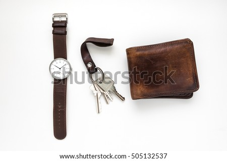 Top view of everyday carry objects made by brown leather on white background
