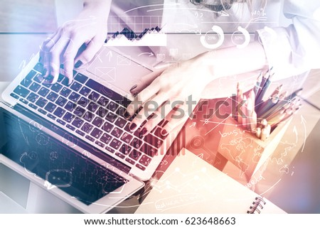 Top view of female hands using laptop with abstract business chart pattern. Accounting concept. Toned image