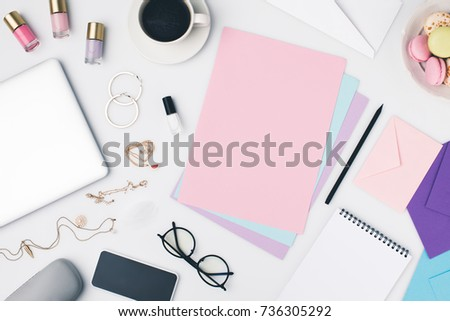 top view of female workplace with beauty things and supplies