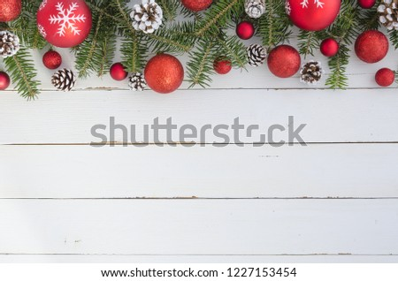 Top view of Fir tree with Pine cones and red balls on wooden table. Christmas decoration background. Flat lay frame mockup #1227153454