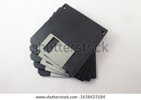 Top view of Floppy discs stacked on white background