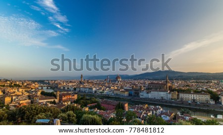 Top view of Florence city timelapse at sunrise with arno river bridges and historical buildings, mountains on background. Green trees, blue cloudy sky at summer day #778481812