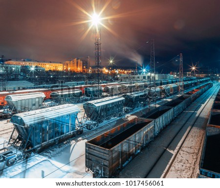 Top view of freight cars at railway station at night in winter,  Murmansk, Russia  #1017456061