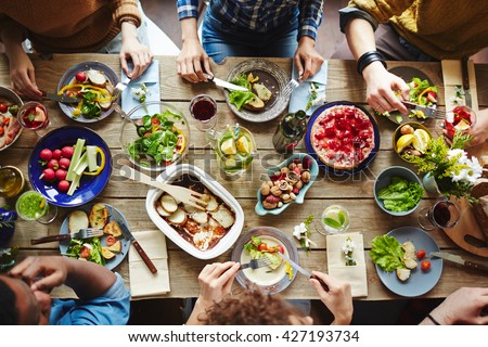 Shutterstock Top view of friends having lunch