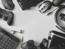 top view of gaming gear, gaming space concept, with mouse, keyboard, headset, joystick, webcam, VR Headset on white background with copy space.